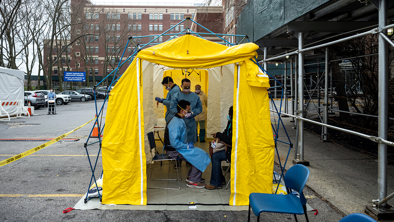 Doctors test hospital staff with flu-like symptoms for COVID-19 at St. Barnabas hospital on March 20, 2020, in New York City. (Misha Friedman/Getty Images)