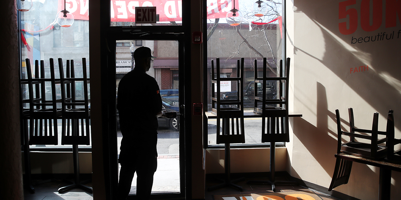A Boston restaurant owner surveys his empty establishment. (Craig F. Walker/The Boston Globe via Getty Images)