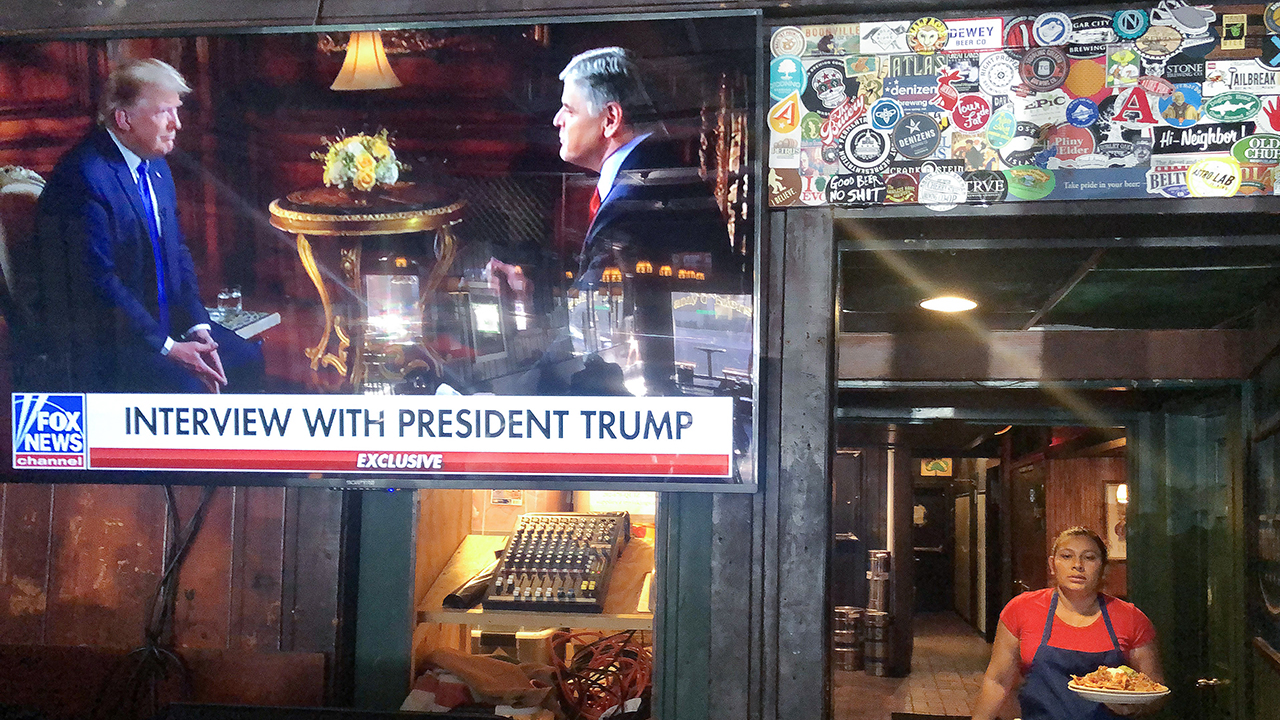 Fox News host Sean Hannity's pre-Super Bowl interview with President Trump shows at a Washington, D.C., bar on Feb. 2. (Mario Tama/Getty Images)