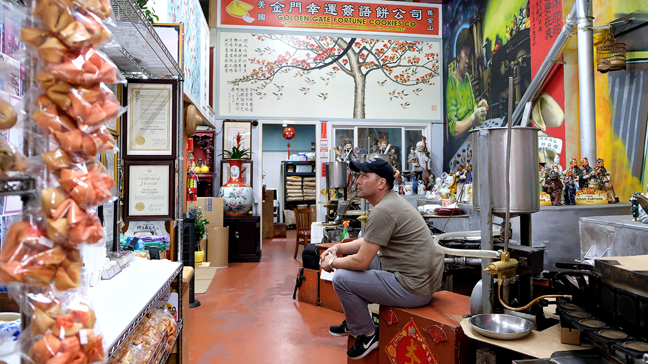 Owner Kevin Chan's Golden Gate Fortune Cookie Factory in San Francisco has struggled as restaurants remain closed in response to the COVID-19 outbreak. (Xinhua/Wu Xiaoling via Getty Images)