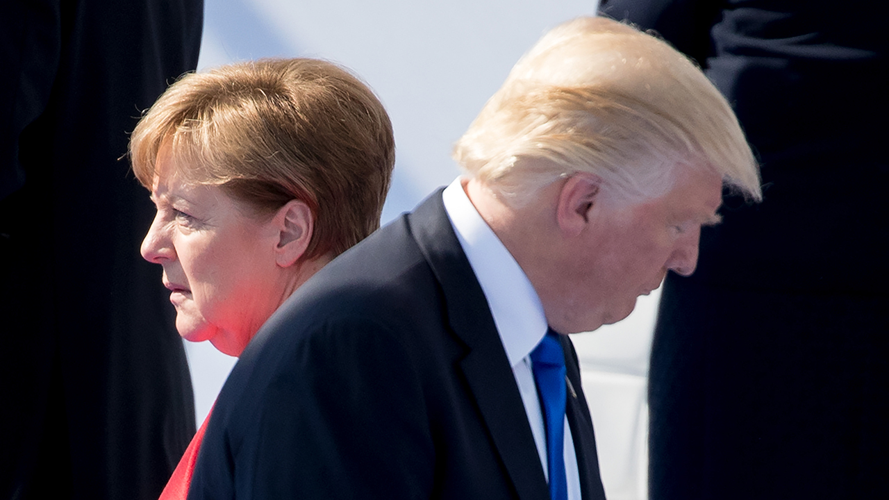 Chancellor Angela Merkel of Germany andPresident Donald Trump walked by each other in 2017. (Kay Nietfeld/picture alliance via Getty Images)
