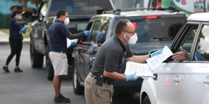 City of Hialeah employees hand out unemployment applications on April 8, 2020, in Hialeah, Florida. (Joe Raedle/Getty Images)