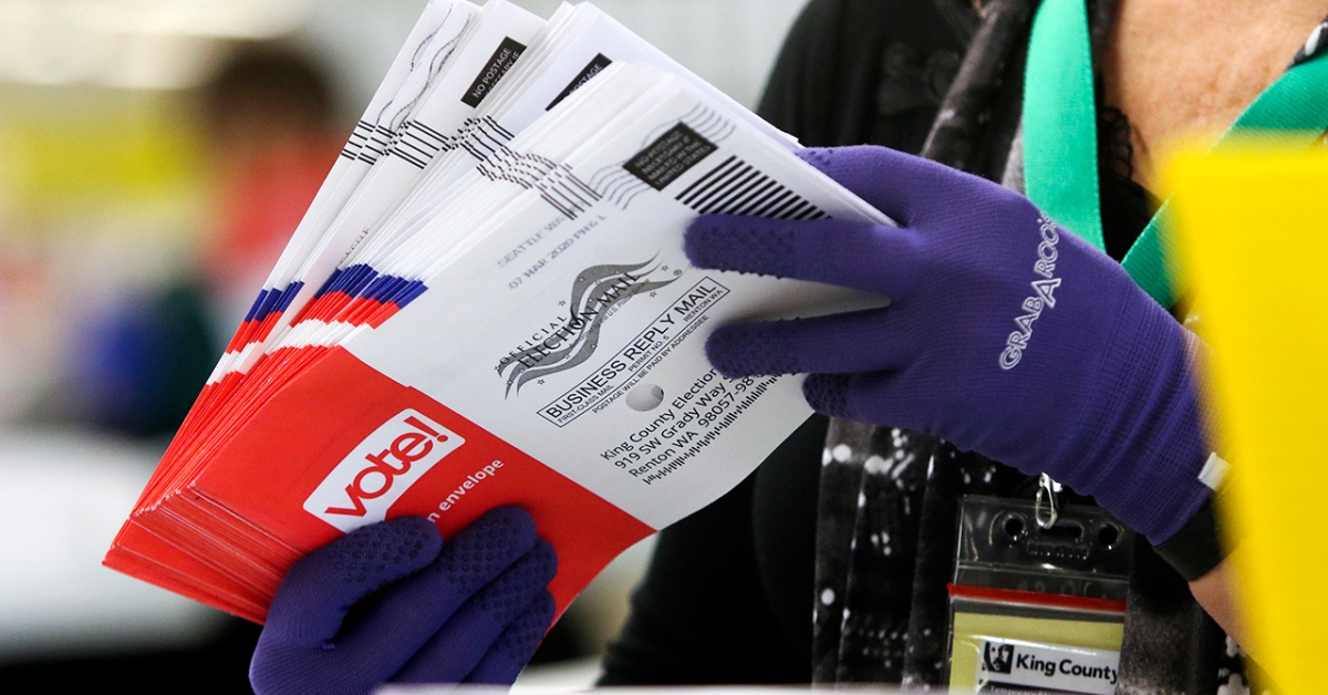 An election worker sorts vote-by-mail ballots for the presidential primary in Renton, Washington, on March 10, 2020. (Jason Redmond/AFP via Getty Images)
