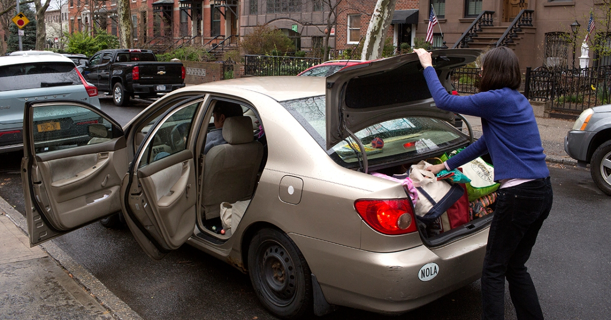 A Brooklyn family prepares to leave New York City on March 25 due to concerns about the spread of COVID-19. (Andrew Lichtenstein/Corbis via Getty Images)
