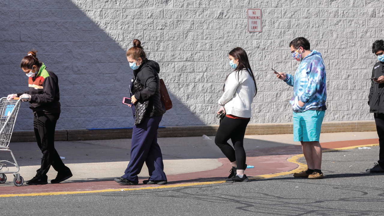 Spaced apart and wearing masks, shoppers wait in line to enter Walmart in Centereach, New York, on April 15. (John Paraskevas/Newsday RM via Getty Images).