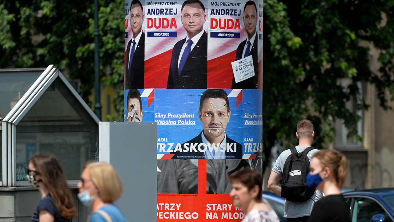 Election posters of presidential incumbent Andrzej Duda and challenger Rafal Trzaskowski on a street in Krakow, Poland, on July 2. A runoff between the two is planned for July 12. (Artur Widak/NurPhoto via Getty Images)