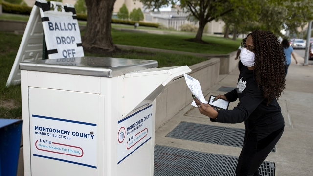 An Ohio voter drops off her ballot at the Board of Elections in Dayton, Ohio, on April 28, 2020. (Megan Jelinger/AFP via Getty Images)