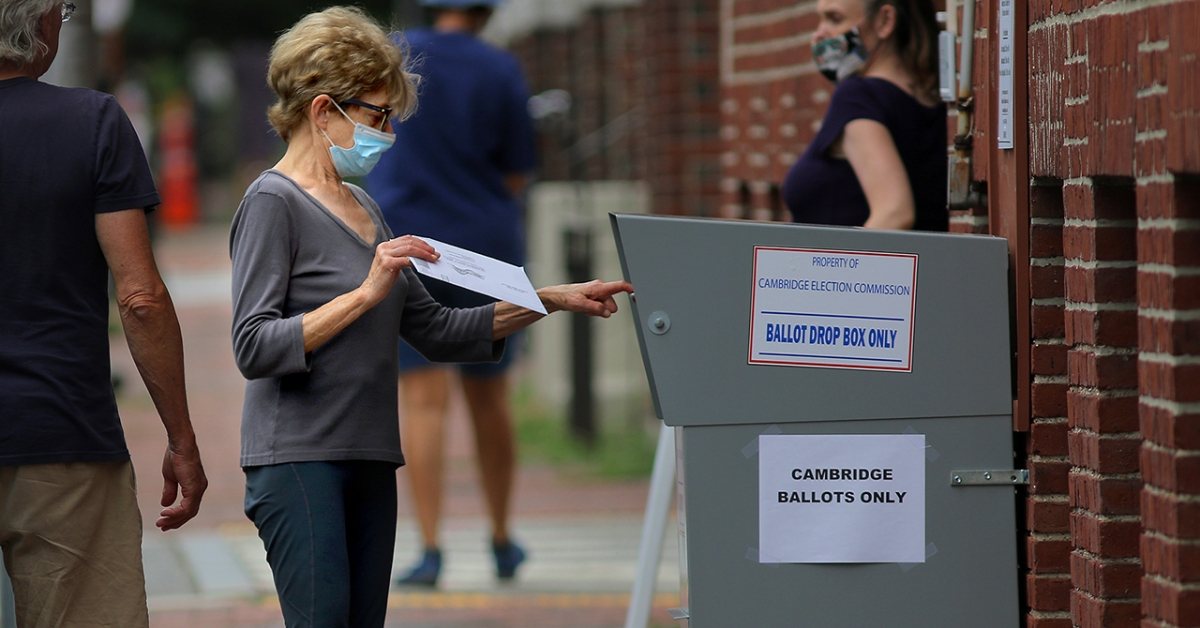 A voter drops off a mail-in ballot in a collection box in Cambridge, Massachusetts, on Aug. 25, 2020. ( Lane Turner/The Boston Globe via Getty Images)
