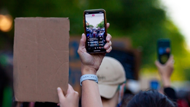 Demonstrators live-stream a protest in Chicago on June 1, 2020. (Javage Logan/Xinhua via Getty)