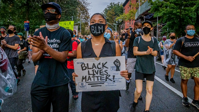 Protesters march in the Brooklyn borough of New York City on Aug. 28, 2020. (Erik McGregor/LightRocket via Getty Images)
