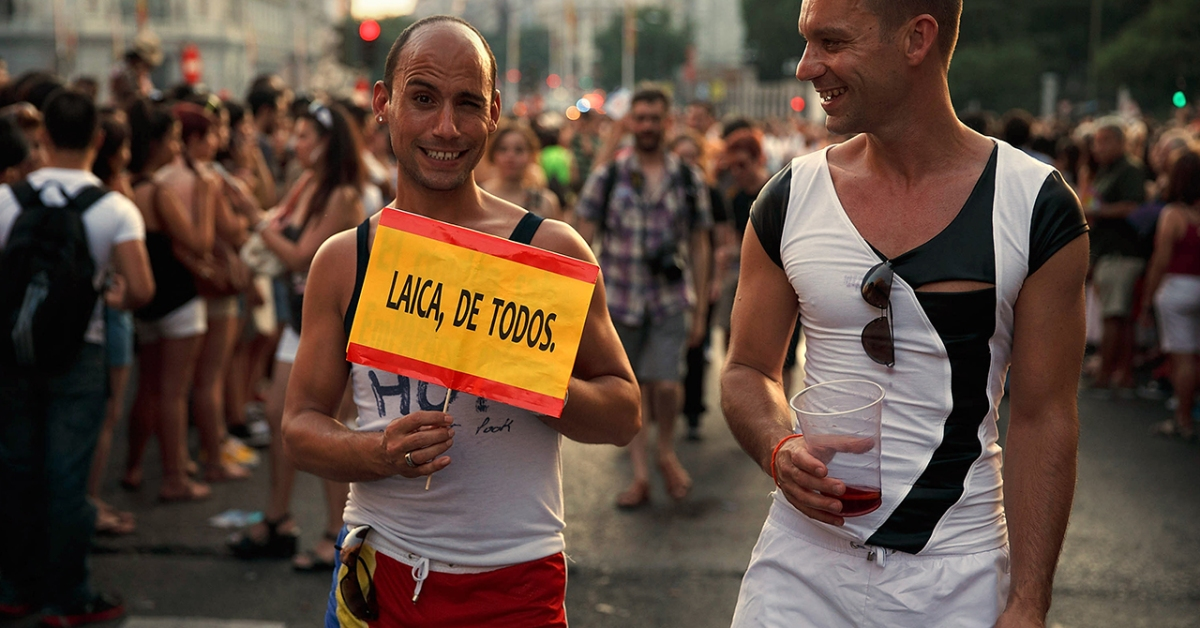 A man holds a sign depicting the Spanish flag calling for non-religious education during the Madrid Gay Pride Parade 2013 on July 6, 2013 in Madrid, Spain. (Gonzalo Arroyo/Getty Images)