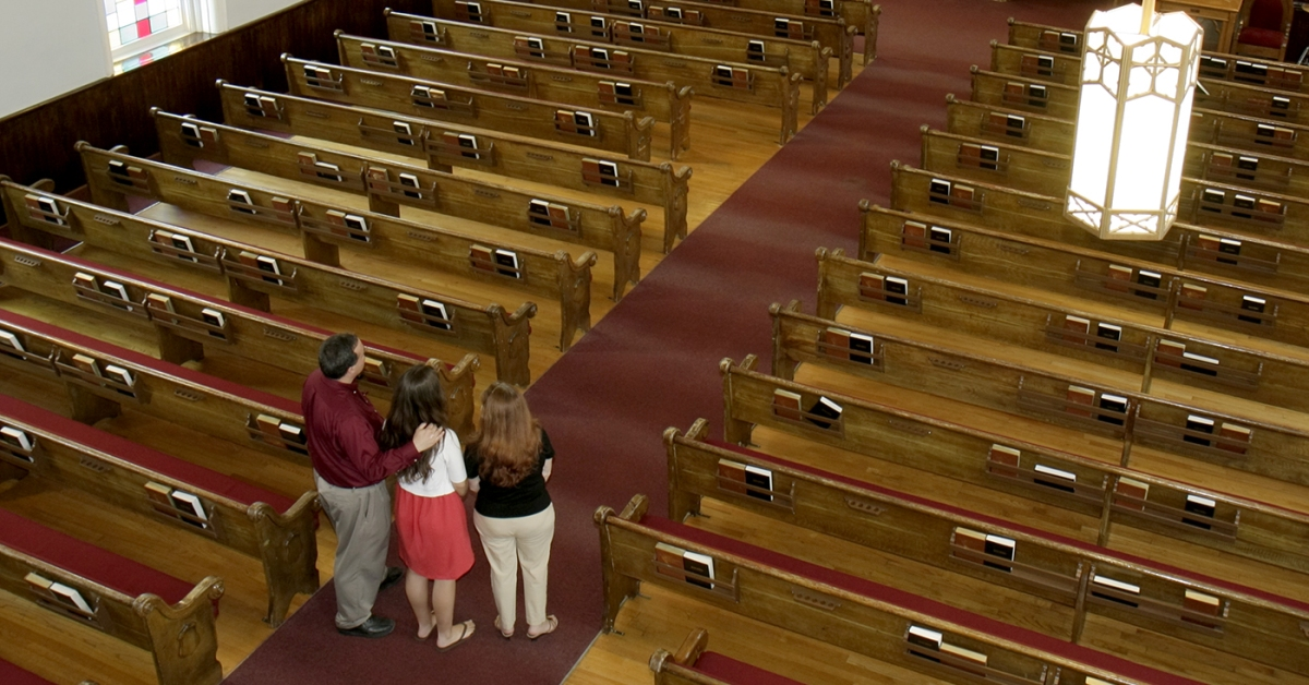 A family inside the Dexter Avenue King Memorial Baptist Church. (Jeffrey Greenberg/Universal Images Group via Getty Images)
