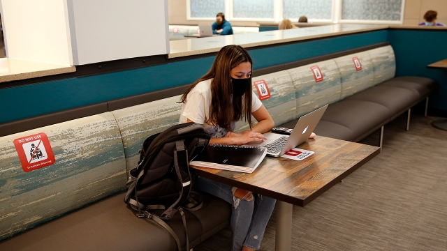 Sophomore Katherine Pacheco sits alone to do remote schoolwork at Boston University in Boston on Sept. 23, 2020. (Jessica Rinaldi/The Boston Globe via Getty Images)