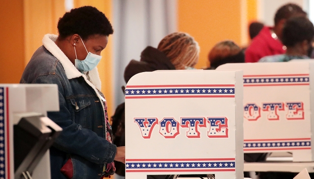 Residents vote at a polling place on Oct. 20, 2020, in Milwaukee. (Scott Olson/Getty Images)
