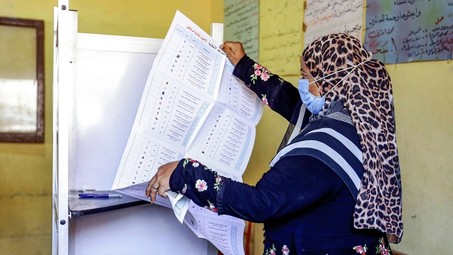 A voter unfolds her ballot at a polling station in el-Ayyat, Egypt, on Aug. 11, 2020. (AFP via Getty Images)