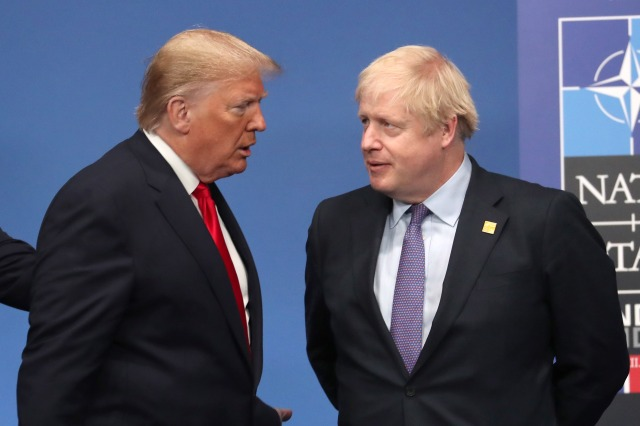 U.S. President Donald Trump talks with British Prime Minister Boris Johnson at the annual NATO summit of heads of government on Dec. 4, 2019, in Watford, England. (Steve Parsons-WPA Pool/Getty Images)