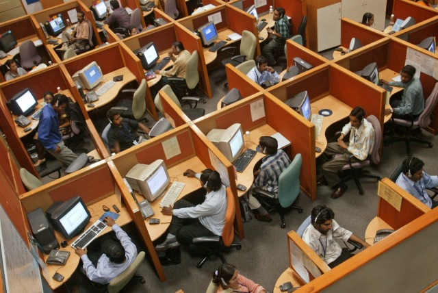 A call center in Bangalore, India. (Gautam Singh/IndiaPictures/Universal Images Group via Getty Images)