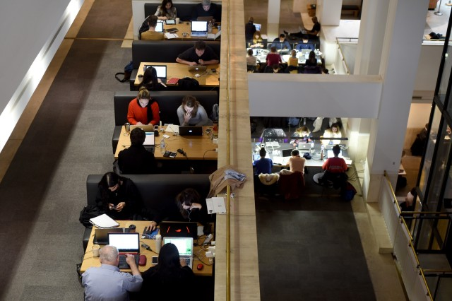 People work on their laptops at the British Library in London. (Kate Green/Anadolu Agency/Getty Images)