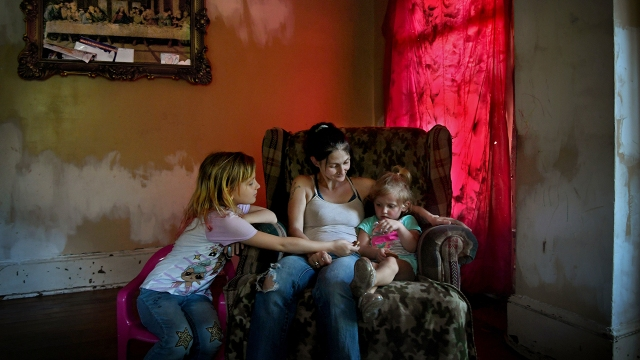 Misty Stanley sits with her daughters Kaylee (left) and Marabella at their home in Welch, West Virginia, on Sept. 9, 2019. McDowell County, West Virginia, is one of the poorest in the nation. (Michael S. Williamson/The Washington Post)