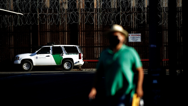 A Border Patrol truck sits on the U.S. side of a wall separating Mexicali, Mexico, from Calexico, California, on July 21, 2020. (Gregory Bull/AP)