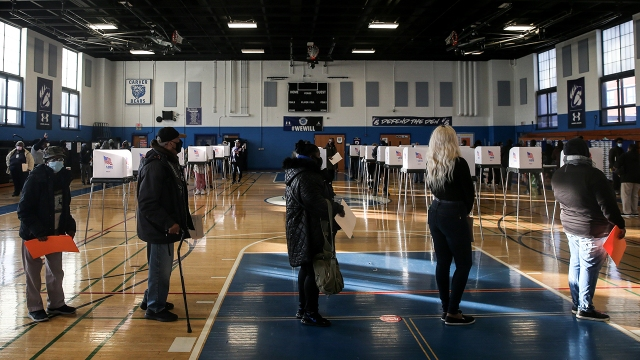 Residents line up to cast their votes at Carver Vocational-Technical High School in Baltimore on Nov. 3, 2020. (J. Countess/Getty Images)