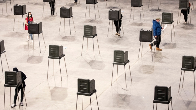 Voting booths in Bangor, Maine, on Nov. 3. (Brianna Soukup/Portland Press Herald via Getty Images)