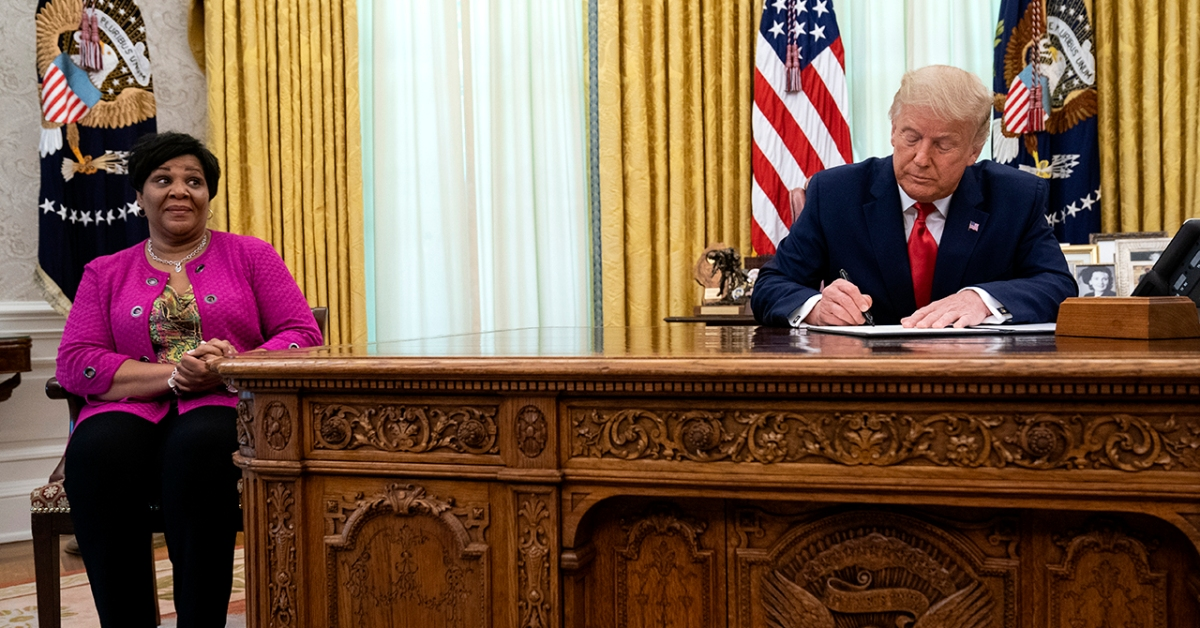 President Donald Trump signs a pardon for Alice Johnson, who was serving a life sentence on drug-related charges, on Aug. 28, 2020, in Washington. (Evan Vucci/AP)
