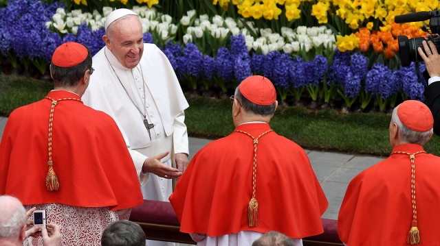 Pope Francis greets cardinals after Easter Mass. (Vincenzo Pinto/AFP via Getty Images)