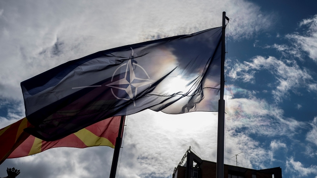 Macedonian and NATO flags wave during the official ceremony of the raising the NATO flag in Skopje on Feb. 12, 2019. (Robert Atanasovski/AFP via Getty Images)