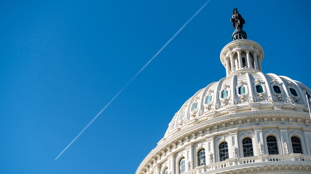 A jet leaves a contrail over the Capitol dome on Friday, Nov. 20, 2020. (Bill Clark/CQ Roll Call via Getty Images)