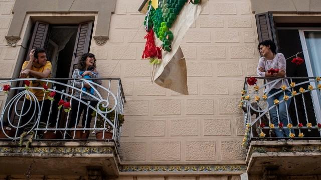 Neighbors speak from their balconies on April 23, 2020, in El Prat del Llobregat, Spain. (David Ramos/Getty Images)