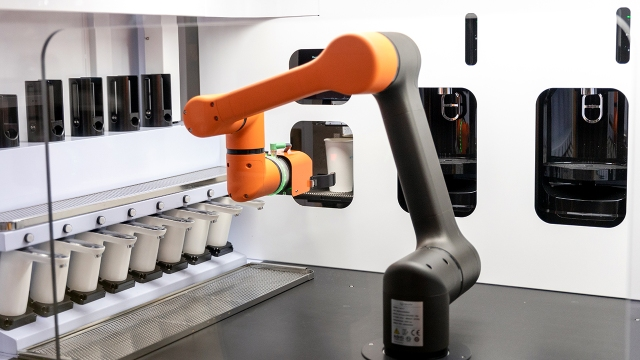 A robot barista that uses artificial intelligence demonstrates its coffee-making process at the 2020 AI Expo Korea in Seoul. (Chris Jung/NurPhoto via Getty Images)