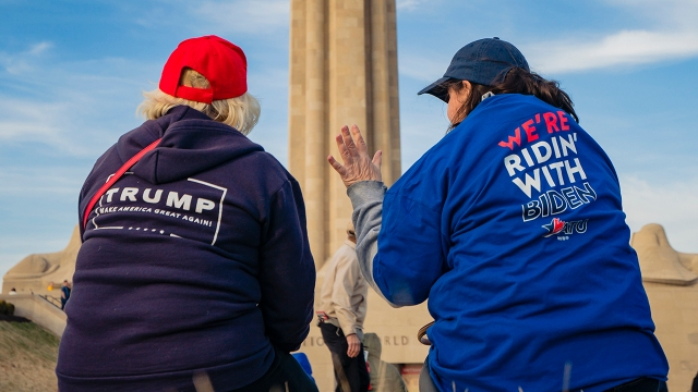 Supporters of Donald Trump and Joe Biden converse before a Biden campaign rally on March 7, 2020 in Kansas City, Missouri. (Kyle Rivas/Getty Images)