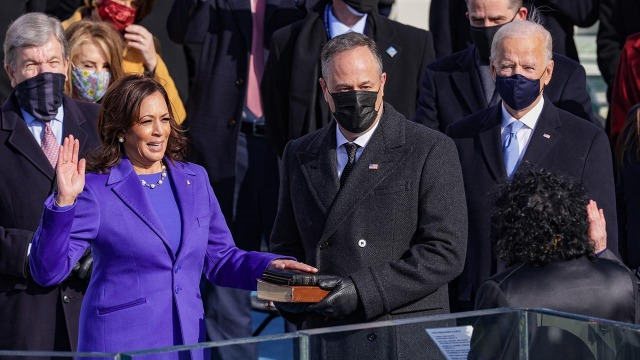 Kamala Harris is sworn in as vice president by Supreme Court Justice Sonia Sotomayor on Jan. 20, 2021, in Washington as Harris' husband, Doug Emhoff, and Joe Biden look on. (Alex Wong/Getty Images)