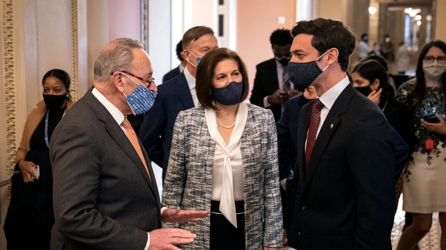 Senate Majority Leader Chuck Schumer speaks with Sens. Catherine Cortez Masto and Jon Ossoff at the U.S. Capitol on Jan. 21, 2021. Ossoff is the first Millennial elected to the Senate. (Drew Angerer/Getty Images)