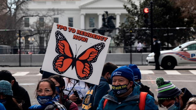 Activists march toward the White House on Feb. 23 in a call for Congress and the Biden administration to pass legislation granting immigrants with Temporary Protected Status a path to citizenship. (Andrew Caballero-Reynolds/AFP via Getty Images)