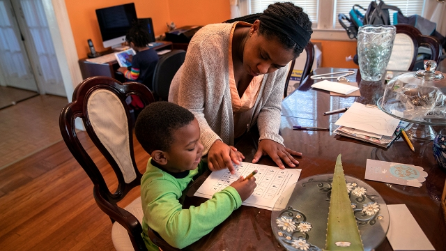 Geri Andre-Major helps her son Max, 5, with his schoolwork on March 26, 2020, in Mount Vernon, New York. (John Moore/Getty Images)
