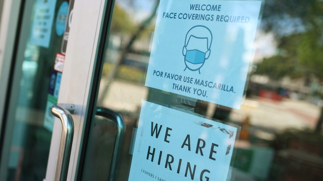 A store in Miami announces job openings on March 5, 2021. Despite recent job gains, U.S. employment in February 2021 was 8.5 million less than in February 2020. (Joe Raedle/Getty Images)