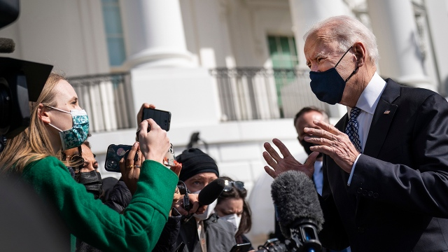 President Joe Biden talks briefly with reporters before boarding Marine One on the South Lawn of the White House on March 19, 2021.