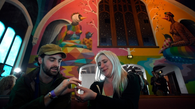 Two people attend services at the International Church of Cannabis on April 20, 2017, in Denver.