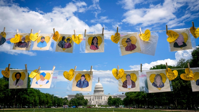 A temporary memorial on the National Mall in Washington, D.C., displays names of those who died from COVID-19 on May 5, 2021. (Drew Angerer/Getty Images)