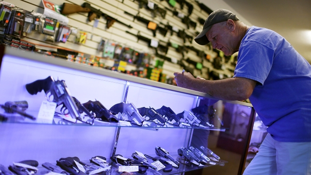A customer completes paperwork for a federal background check while purchasing a handgun on Jan. 5, 2016, in Delray Beach, Florida.