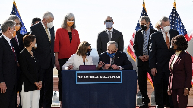 House Speaker Nancy Pelosi and Senate Majority Leader Chuck Schumer sign the American Rescue Plan Act outside the U.S. Capitol after the House voted to pass the $1.9 trillion COVID-19 relief plan on March 10, 2021.