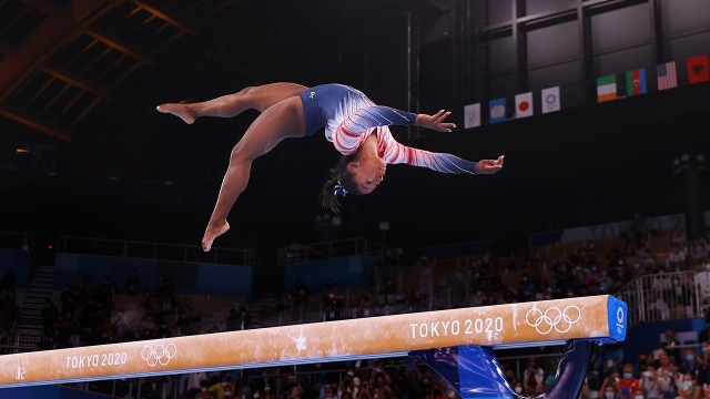 Simone Biles competes in the women's balance beam final in the 2020 Olympic Games on Aug. 3, 2021, in Tokyo.