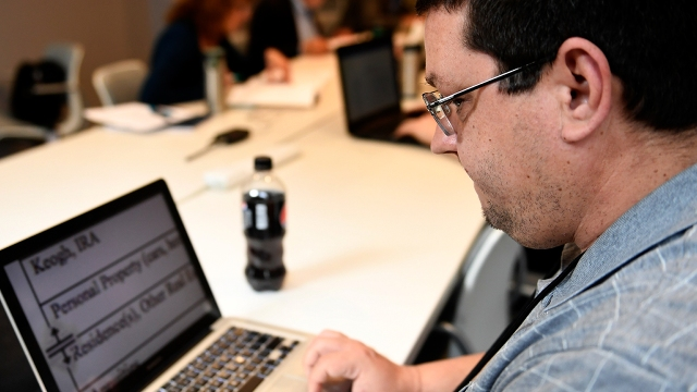 A man reads magnified text on his computer during a session of a vocational program for the visually impaired in Denver.