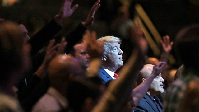 Then-presidential nominee Donald Trump attends a worship service at the International Church of Las Vegas on Oct. 30, 2016, in Las Vegas.