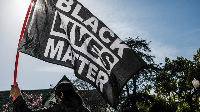 A protester holds a Black Lives Matter flag at a demonstration in Los Angeles on April 20, 2021, hours after former Minneapolis police officer Derek Chauvin was found guilty in the murder of George Floyd.