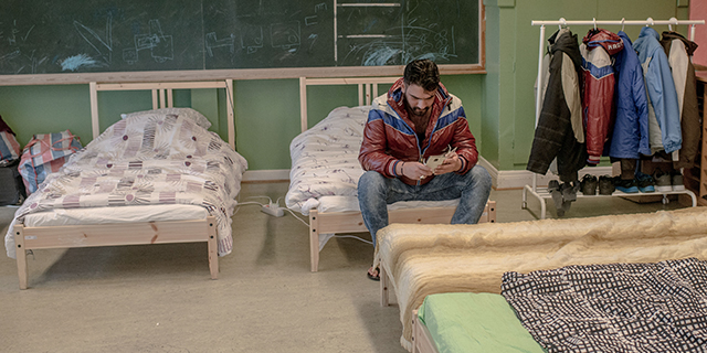 Youssef Atamini of Syria checks his mobile phone at a temporary home for asylum seekers in Kladesholmen, Sweden, in February 2016. (David Ramos/Getty Images)