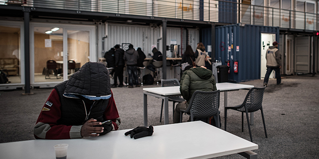 Migrants at the processing center for migrants and refugees in northern Paris in November 2016. (Philippe Lopez/AFP/Getty Images)
