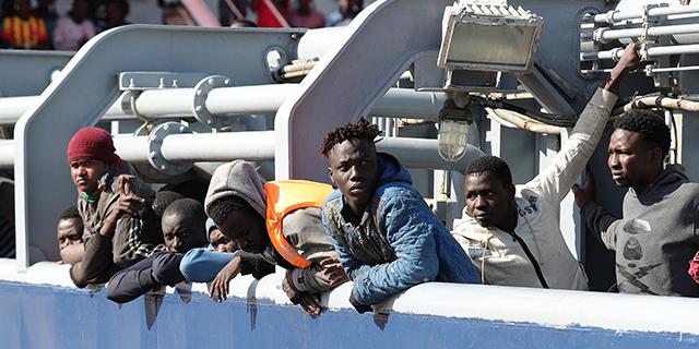 Migrants rescued off the coast of Libya wait to disembark from the supply vessel OOC Panther in the Sicilian port of Messina, Italy, in April 2017. (Sipa via AP)